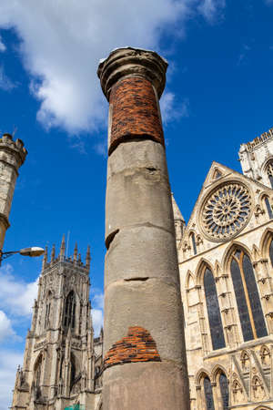york minster: The historic Roman Column with York Minster in the background in York, England. Stock Photo