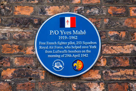 blue plaque: A blue plaque dedicated to Yves Mahe, a Free French fighter pilot who helped save York from Luftwaffe bombers during the second world war.