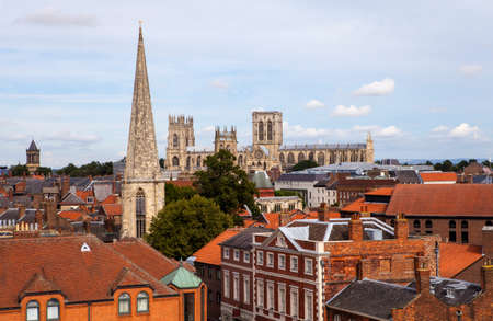 york minster: Looking out at the view from the top of Clifford's Tower in York, England.  The sights include York Minster, St Wilfrid's Catholic Church and St. Mary's Church.