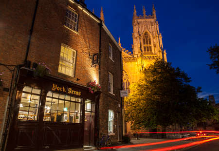 york minster: YORK, UK - AUGUST 29TH 2015: A view of York Minster and the York Arms public house in York, on 29th August 2015.