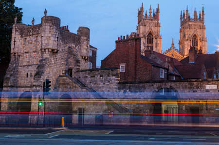 minster: An evening view of Bootham Bar and the towers of York Minster in York, England.
