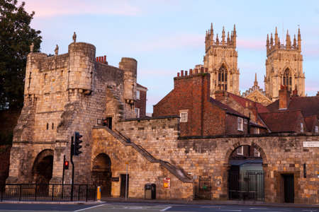minster: An evening view of Bootham Bar and the towers of York Minster in the background in York, England.