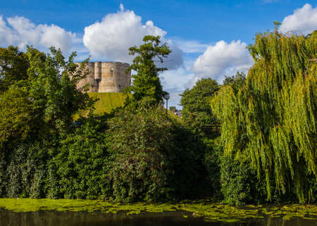 ouse: The beautiful view of the Clifford's Tower overlooking the River Ouse in York, England. Editorial
