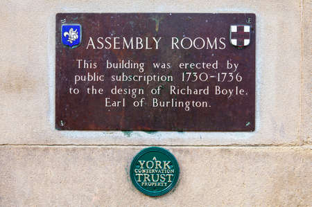 A plaque detailing the history of the Assembly Rooms building in York, England. Editorial
