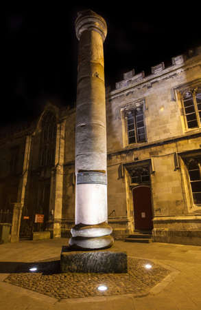 legion: A night-time view of the Roman Column in York.  The column once stood in the headquarters of the building of the fortress of the sixth legion in York. Editorial