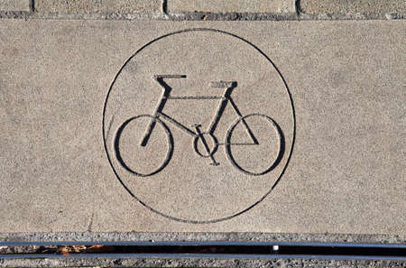 super highway: A Cycle Path Sign in the Pavement. Editorial