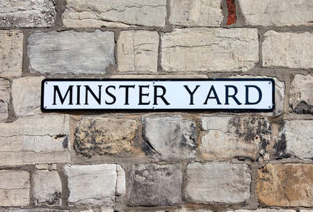yard sign: A street sign for Minster Yard in York, England.