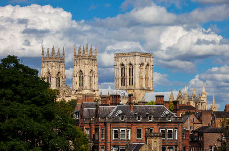 york minster: A view of the magnificent York Minster over the rooftops of York, England.