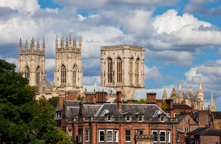 york minster: A view of York Minster over the rooftops of York, England.