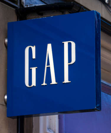 retail therapy: YORK, UK - AUGUST 26TH 2015: The sign for the GAP store in York on 26th August 2015.  Founded in 1967, GAP is a multinational clothing and accessories retailer. Editorial