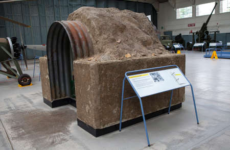raid: CAMBRIDGESHIRE, UK - OCTOBER 5TH 2015: An Anderson Air Raid Shelter on display at the Imperial War Museum Duxford in Cambridgeshire, on 5th October 2015. Editorial