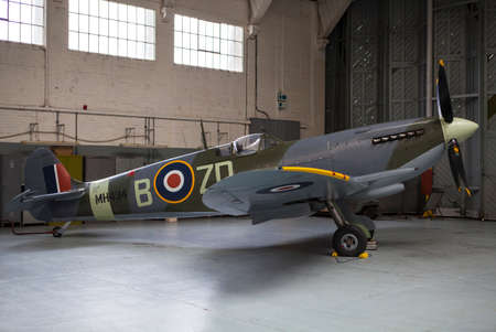 cambridgeshire: CAMBRIDGESHIRE, UK - OCTOBER 5TH 2015: A Supermarine Spitfire at the Imperial War Museum Duxford in Cambridgeshire, on 5th October 2015. Editorial