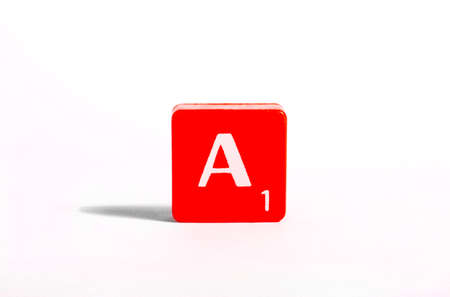 spelt: A red tile portraying the letter A.