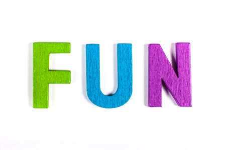 coloured: FUN spelt out with bright coloured letters over a white background. Stock Photo