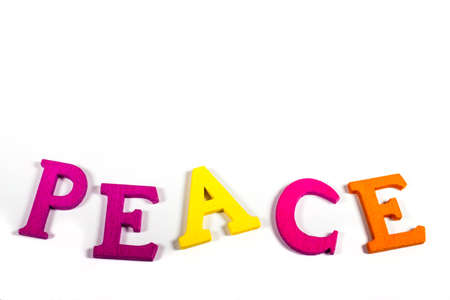 neutrality: PEACE spelt out with bright coloured letters over a white background.