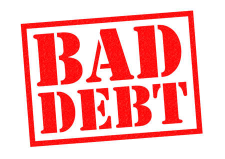 wealth: BAD DEBT red Rubber Stamp over a white background. Stock Photo
