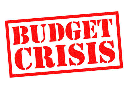 budget crisis: BUDGET CRISIS red Rubber Stamp over a white background.