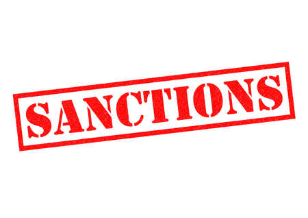 imposed: SANCTIONS red Rubber Stamp over a white background.