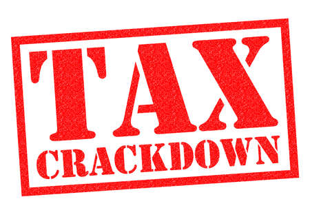avoiding: TAX CRACKDOWN red Rubber Stamp over a white background.