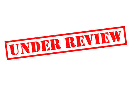 UNDER REVIEW red Rubber Stamp over a white background.