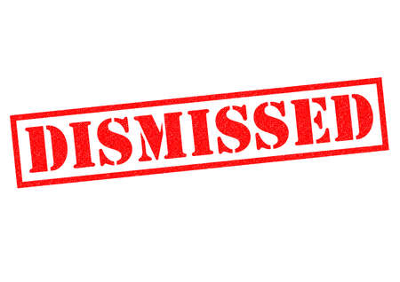 let out: DISMISSED red Rubber Stamp over a white background. Stock Photo
