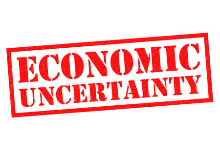 uncertainty: ECONOMIC UNCERTAINTY red Rubber Stamp over a white background.
