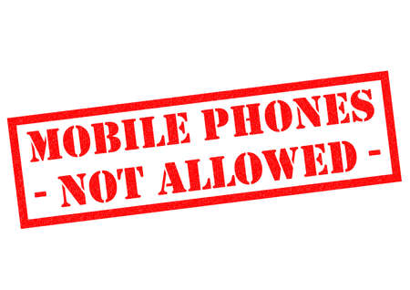 not permitted: MOBILE PHONES NOT ALLOWED red Rubber Stamp over a white background. Stock Photo