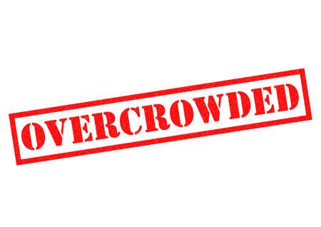 overcrowding: OVERCROWDED red Rubber Stamp over a white background. Stock Photo