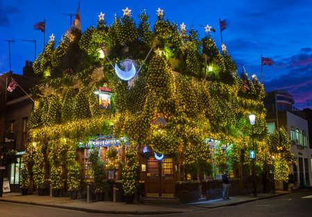 public house: LONDON, UK - DECEMBER 9TH 2015: The Churchill Arms Public House decorated within an array of Christmas Trees to celebrate the festive season in Notting Hill, London on 9th December 2015.