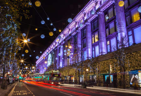 oxford street: LONDON, UK - DECEMBER 9TH 2015: A view of the beautifully illuminated Selfridge department Store during Christmas on Oxford Street in London, on 9th December 2015. Editorial