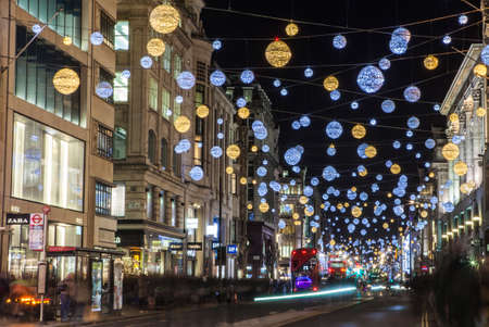 oxford street: LONDON, UK - DECEMBER 9TH 2015: A view of a bustling Oxford Street during the lead up to Christmas in London, on 9th December 2015.