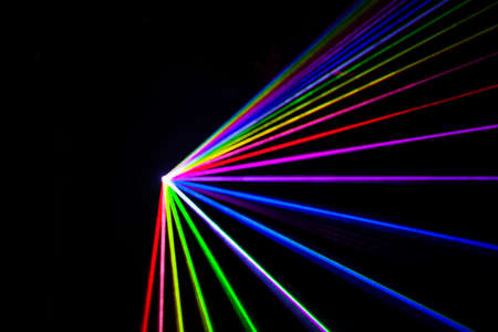 Out of focus colorful Laser effect over a plain black background.