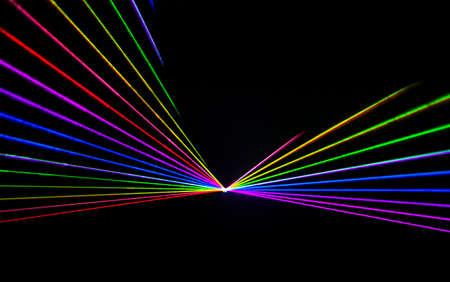 Kleurrijke Laser effect over een effen zwarte achtergrond. Stockfoto