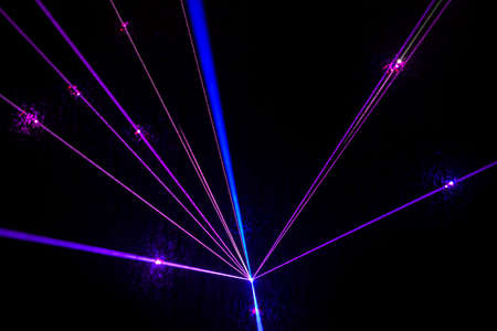 Colorful Laser effect over a plain black background. Фото со стока