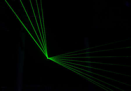 fiber optic lamp: Green Laser effect over a plain black background.