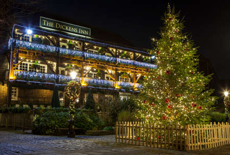 katherine: A view of The Dickens Inn Public House at situated in St. Katherine Docks in London during Christmas. Editorial