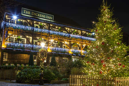 public house: A view of The Dickens Inn Public House at situated in St. Katherine Docks in London during Christmas. Editorial