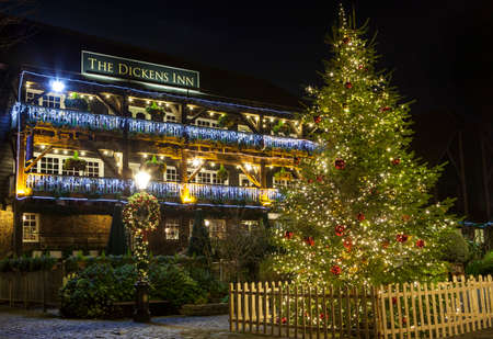 dickens: A view of The Dickens Inn Public House at situated in St. Katherine Docks in London during Christmas. Editorial