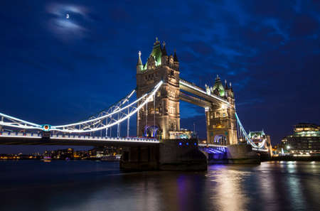 moon  metropolis: A dusk-time view of the magnificent Tower Bridge spanning over the River Thames in London.