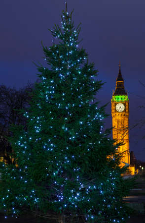 election night: A Christmas Tree with the Elizabeth Tower in the background, in London.