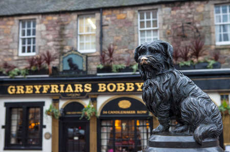 A statue of Greyfriars Bobby situated outside the Greyfriars Public House in Edinburgh, Scotland. Bobby was a Skye Terrier who supposedly spent 14 years guarding the grave of his owner until he died in 1872.