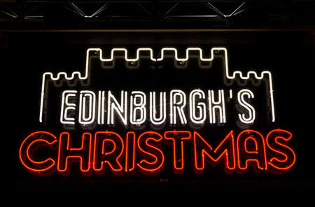 hogmanay: EDINBURGH, SCOTLAND - JANUARY 3RD 2016: A neon sign celebrating the Christmas season in Edinburgh, on 3rd January 2016.