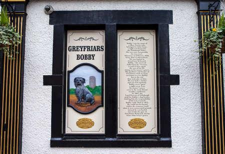 bobby: EDINBURGH, SCOTLAND - JANUARY 3RD 2016: An information board at the Greyfriars Bobby Public House detailing the history of Greyfriars Bobby in Edinburgh, on 3rd January 2016.
