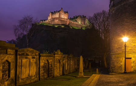 churchyard: View of the magnificent Edinburgh Castle from the churchyard of St. Cuthberts Church. Editorial