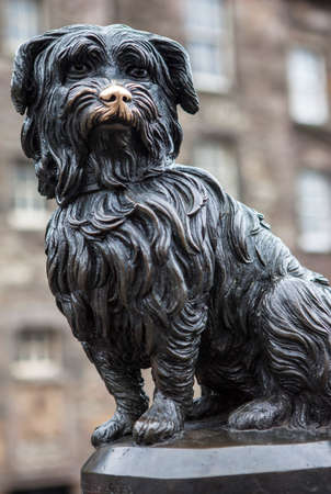 A statue of Greyfriars Bobby in Edinburgh, Scotland.  Bobby was a Skye Terrier who supposedly spent 14 years guarding the grave of his owner until he died in 1872.