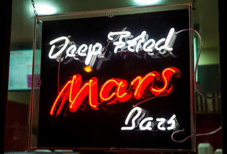 novelty: A fast food restaurant in Edinburgh advertising Deep Fried Mars Bars.  Deep Fried chocolate is a novelty and delicacy originating from Scotland.