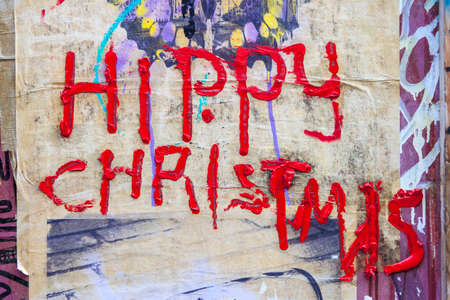 grungey: LONDON, UK - JANUARY 13TH 2016: Hippy Christmas painted on an urban wall in London, on 13th January 2016.