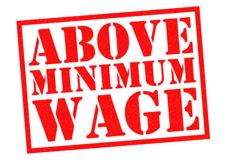 pay check: ABOVE MINIMUM WAGE red Rubber Stamp over a white background.