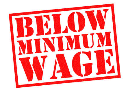 pay check: BELOW MINIMUM WAGE red Rubber Stamp over a white background. Stock Photo