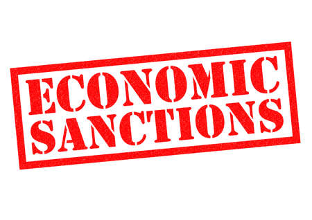 budgetary: ECONOMIC SANCTIONS red Rubber Stamp over a white background. Stock Photo